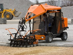 Paver laying machines and paving tools