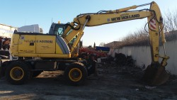Колесен багер New Holland MH Plus